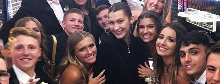 Bella Hadid crashes high school senior prom in New York and poses with students on party bus